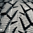 Protector and snow spikes of winter tire - Stock Photo