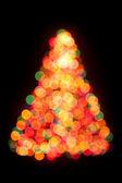 Christmas tree bokeh light — Stock Photo