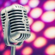 Retro microphone on purple disco background — Stock Photo