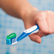 Toothbrush in hand — Stock Photo