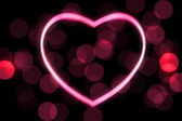 Glowing heart shape with bokeh lights — Stock Photo