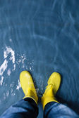 Rubber boots in the water — Stok fotoğraf