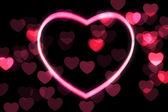 Glowing heart shape with bokeh lights — Stock Photo