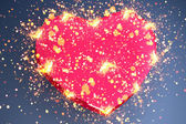 Pink heart shape with sparks — Stock Photo