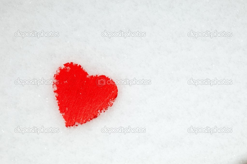Red heart on the snow  Stock Photo #19495327