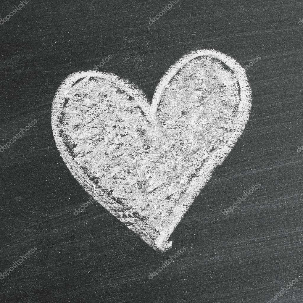 Love heart symbol on a blackboard — Stock Photo #19496615