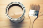 Brown paint can and brush — Stock Photo