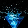 Blue splashing cocktail on black — Stock Photo #22493995