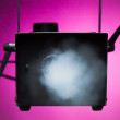 Smoke machine in action - Stock Photo