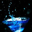 Blue splashing cocktail on black — Stock Photo #23134200