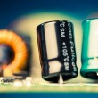 Stock Photo: Electronic components on printed circuit board, shallow depth of field