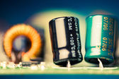 Electronic components on a printed circuit board, shallow depth of field — Stock Photo