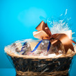 Gift basket against blue background — Stock Photo #25631353
