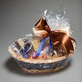 Gift basket on grey — Stock Photo
