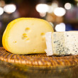 Maasdam cheese and roquefort cheese — Stock Photo