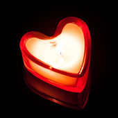 Burning candle heart — Stock Photo