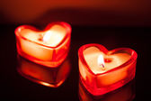 Burning candle hearts — Stock Photo