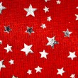 Red Christmas stars background — Stock Photo #30398233