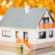 Festive house against golden bokeh background — Stock Photo