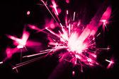Purple christmas sparkler — Stock Photo