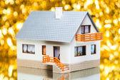 House against golden bokeh background — Stock Photo