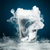 Glass of water with ice vapor — Stock Photo