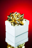 Gift with golden ribbon bow — Stock Photo
