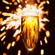 Champagne glass against christmas sparkler background — Stock Photo #34666865