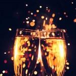 Champagne glass against christmas sparkler background — Stock Photo #34666871