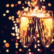 Champagne glass against christmas sparkler background — Stock Photo