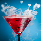 Red cocktail with ice vapor — Stock Photo