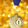 Golden medal on shiny background — Stock Photo
