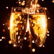 Champagne glass against christmas sparkler background — Stock Photo #35133751