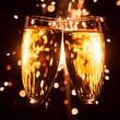 Champagne glass against christmas sparkler background — Stock Photo #35133751