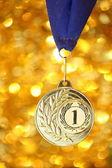 Golden medal on shiny background — Stock Photo