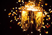 Champagne glass against christmas sparkler background — Stock Photo