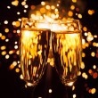 Champagne glass against christmas sparkler background — Stock Photo #35800483