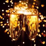 Champagne glass against christmas sparkler background — Stock Photo #35800483