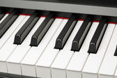 Grand piano ebony and ivory keys — Stock Photo