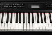 Keys of digital piano synthesizer — Stock Photo