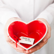 Red heart shape in hands — Stock Photo #36576597