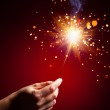Sparkler in hand — Stock Photo #37003743