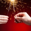 Sparklers in hands — Stock Photo #37004257