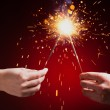 Sparklers in hands — Stock Photo #37004281