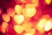 Glowing red hearts background — Stock Photo