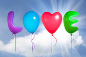 Love text shaped color balloons — Stok fotoğraf