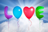 Love text shaped color balloons — Stock Photo