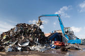 Metal scrap loading machine — Stock Photo