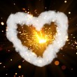 Stock Photo: Sparkler with heart shaped smoke ring