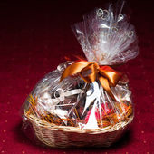 Gift basket against red background — Stock Photo